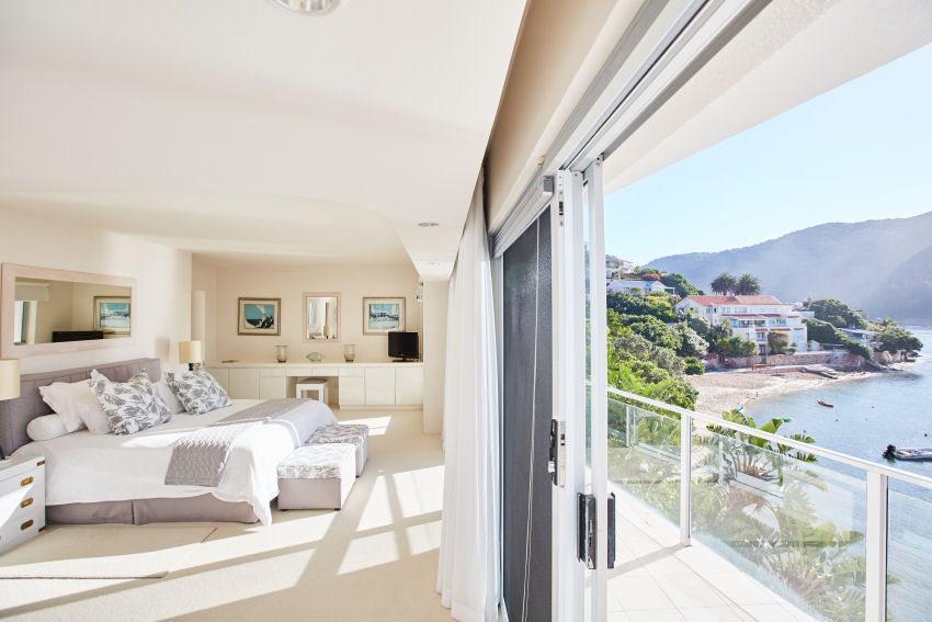 Milkwood Bay: en-suite master bedroom with king-size bed and private balcony with lagoon view