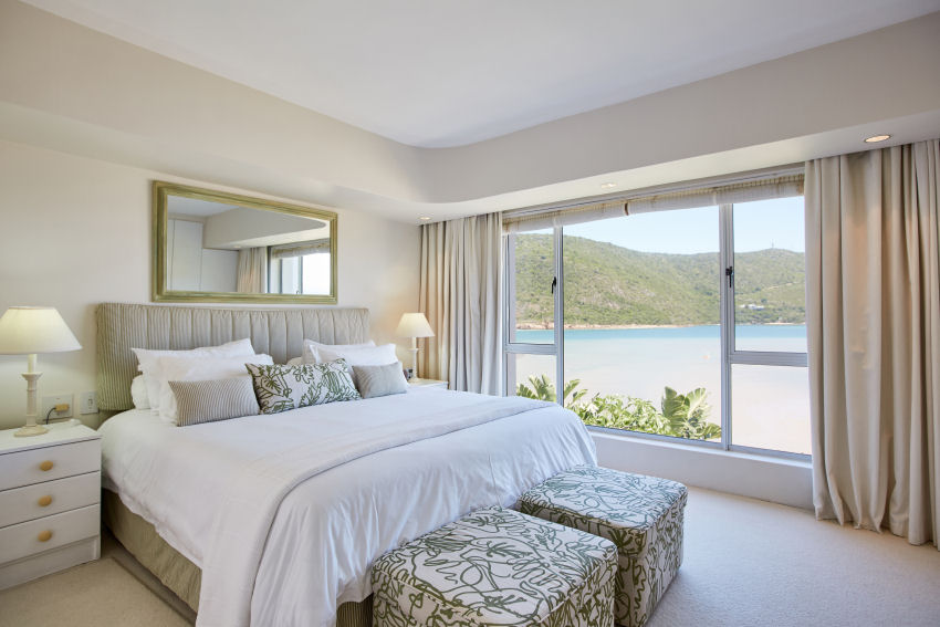 Milkwood Bay: en-suite bedroom two with king-size bed and expansive lagoon views