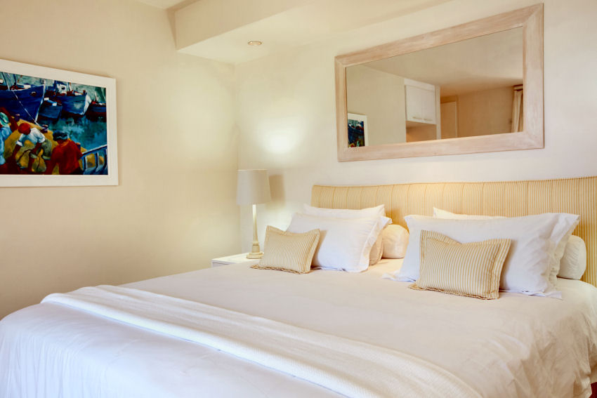 Milkwood Bay: en-suite bedroom three with king-size, extra-length bed and private balcony overlooking garden and lagoon