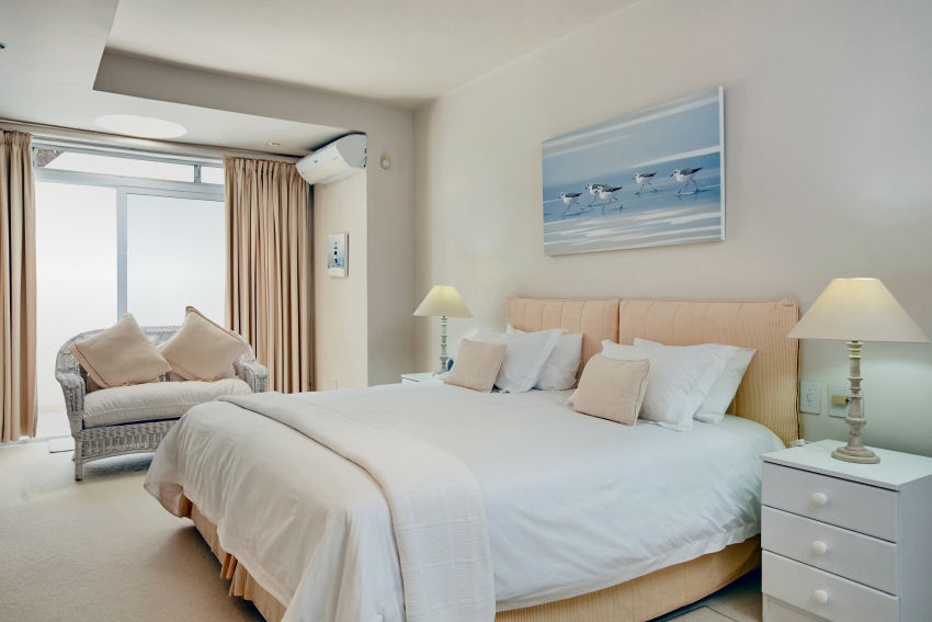 Milkwood Bay: en-suite bedroom four with king-size bed and side balcony with lagoon views from balcony only