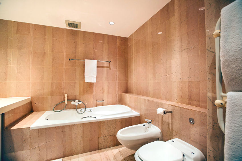 Milkwood Bay: marble-tiled bathroom three, en-suite with bath and separate shower