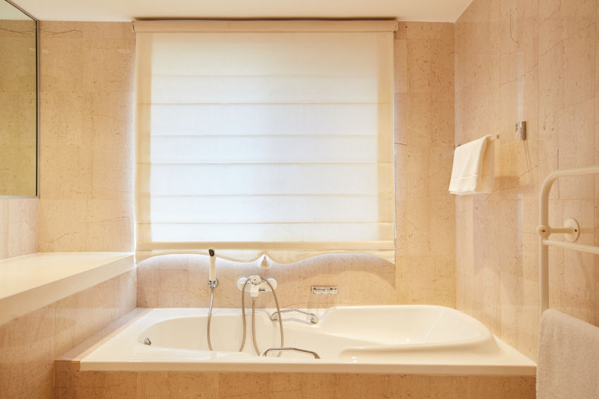 Milkwood Bay: marble-tiled bathroom four, en-suite with bath and separate shower