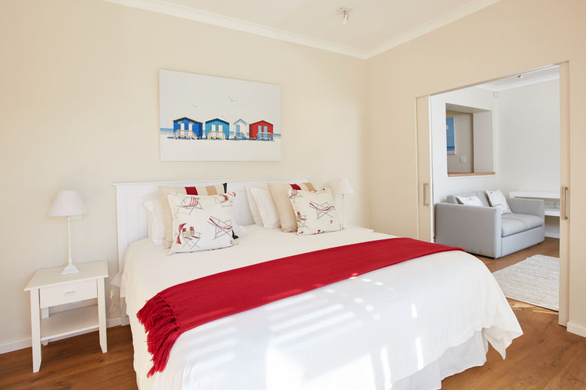 Number Eleven - en-suite bedroom three downstairs offers a king-size bed, walk-in wardrobe, separate study, lounge with sofa bed and direct access to the pool and garden