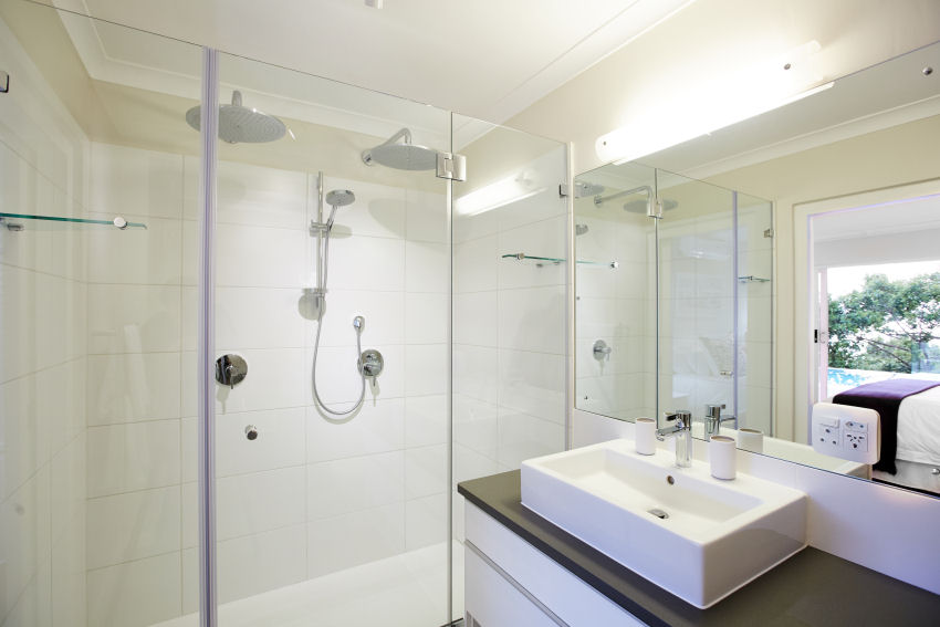 Number Eleven - bathroom four downstairs en-suite bathroom includes basin, bath, separate shower with rainshower head, toilet and bidet