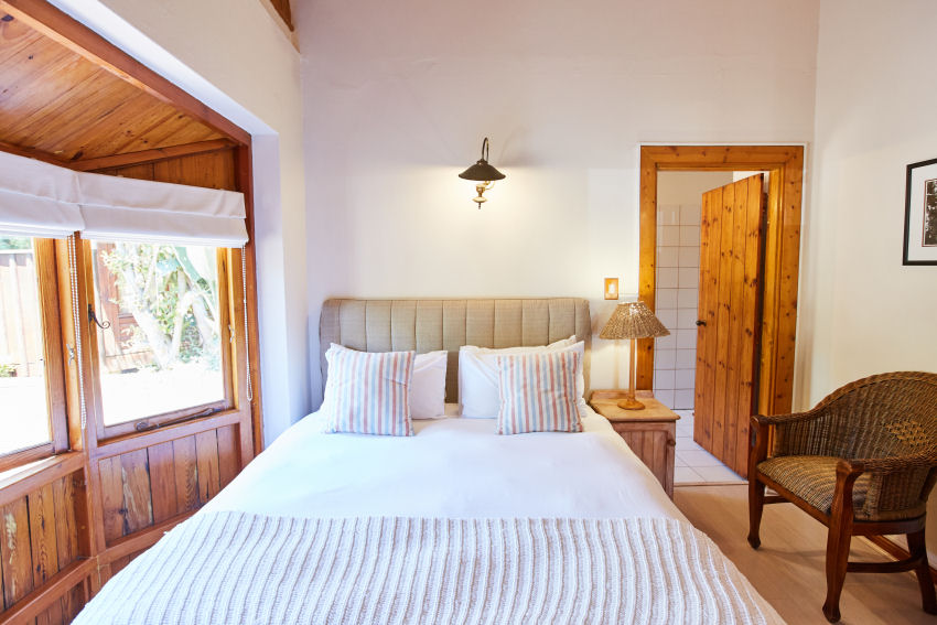Paquita: en-suite bedroom two with queen-size bed and view over courtyard