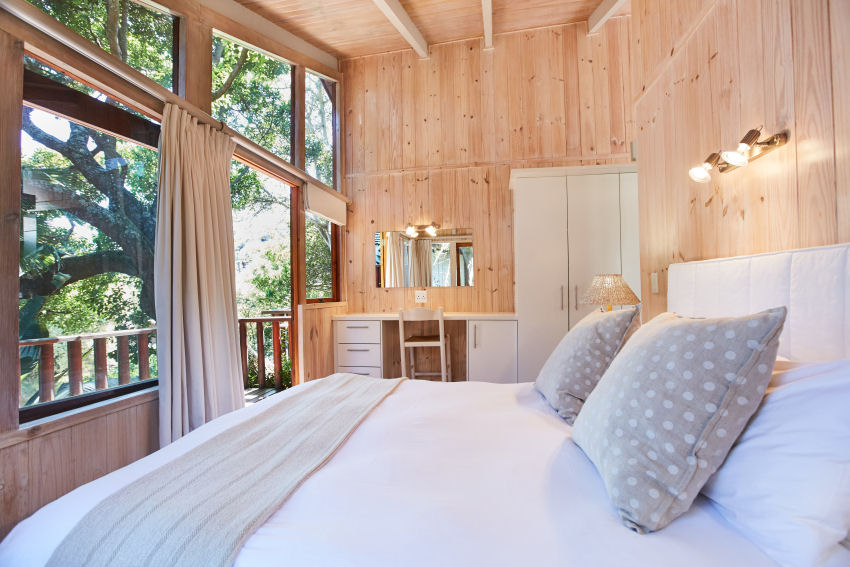 Under Milkwood: Maerose chalet  main bedroom: luxury chalet with white washed interior