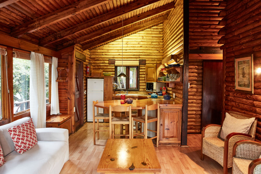 Under Milkwood: looking from chalet living room to kitchen